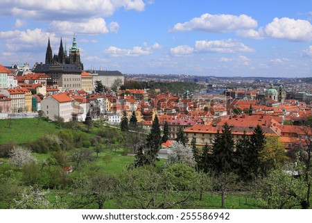 View on the spring Prague gothic Castle with the green Nature and flowering Trees, Czech Republic - stock photo