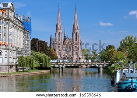 View on the St. Paul Church from the Ill river in Strasbourg, France - stock photo