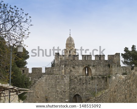 View on the tower of Dormition Abbey and Jerusalem Walls, Jerusalem, Israel. - stock photo