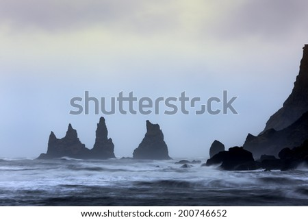 View on three rock pillars at Vik. - stock photo