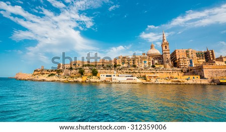 view on Valletta with its architecture from the sea - stock photo