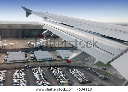view on wing during landing at heathrow airport, london, UK - stock photo