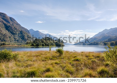 View onto a Scottish loch between hills and slopes, HDR version - stock photo