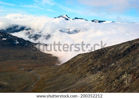 View onto Galdhopiggen from the path to Glittertind in the Jotunheimen National Park in Norway. Galdhopiggen is Norway's highest, Glittertind its second highest peak.