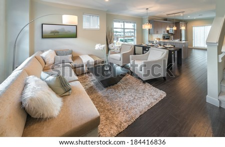 View, outlook at the luxury modern living suite : dining room and the kitchen at the back with two modern chairs in front of. Interior design of a brand new house. - stock photo