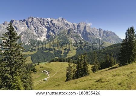 View over alpine pastures and woods to mountain Hochkonig, Dienten, Salzburg, Austria - stock photo