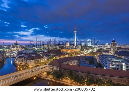 View over Berlin Skyline (TV Tower, Alexanderplatz, Town Hall, River Spree and Berlin Cathedral) at evening after sunset, Germany, Europe - stock photo