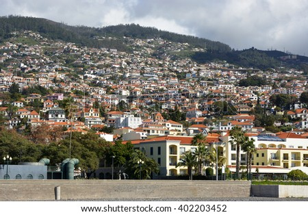 View over city and surrounding hills from the seafront promenade in Funchal, Madeira, Portugal