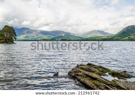 View over Derwent water with mountains in the background  - stock photo