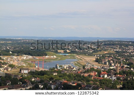view over dortmund hoerde, where a lake is spreading on site of a former steelmill as a sign of structural change that has changed the ruhr region - stock photo