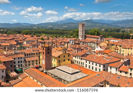 View over Italian town Lucca with typical terracotta roofs - stock photo