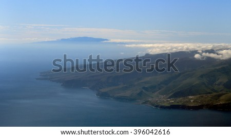View over La Gomera to El Hierro from the flight approaching Tenerife South Airport, Canary Islands, Spain. - stock photo