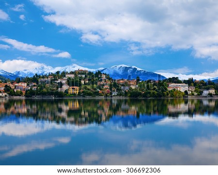 View over Lake Maggiore and Alps mountains with Verbania town in Northern Italy. - stock photo