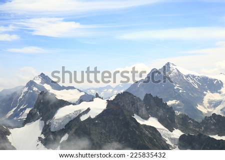View over mountains from mount Titlis, Engelberg, Switzerland. 3200m above sea level. - stock photo