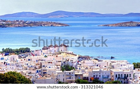 View over Mykonos city on the Island of Mykonos, with in the distance the famous windmills