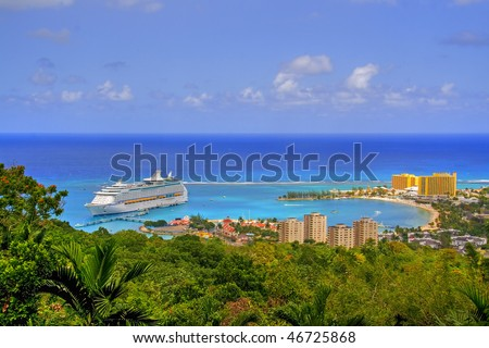 View over Ocho Rios port town, Jamaica, with anchored cruise liner - stock photo
