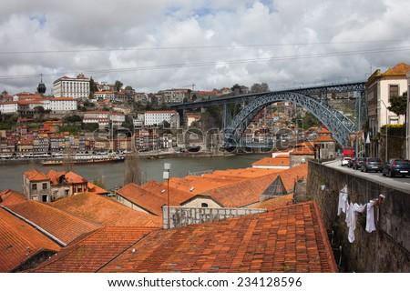 View over picturesque old city of Vila Nova de Gaia and Porto in Portugal, Dom Luis I Bridge over Douro river on far right. - stock photo