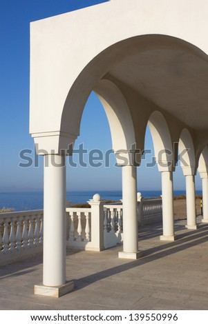 View over the Aegean Sea from the porch with arches and columns of orthodox church Profitis Ilias in Keratea, near Lavrio, in East Attika, Greece. - stock photo