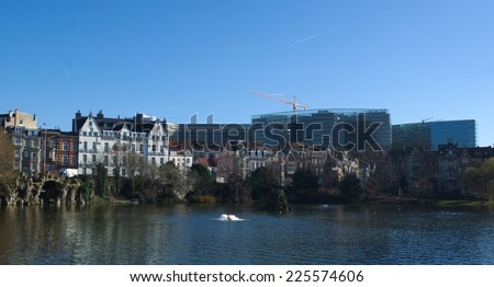 View over the artificial lake with fountain in front of the european commission building in brussels. - stock photo
