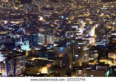 View over the city center of La Paz, Bolivia at night. On the left side the Metropolitan Cathedral on Murillo Square can be seen.   - stock photo