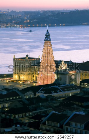 view over the city of lisbon, bigest christmas tree of europe, we can se the tagus river and the other side . - stock photo