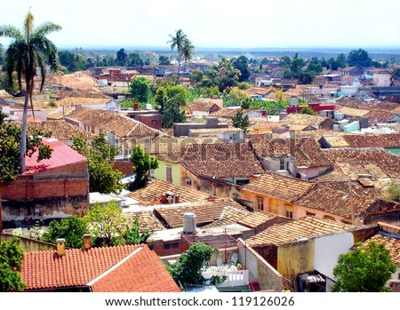 view over the colonial UNESCO city of Trinidad in Cuba with his pastel colors and rooftops - stock photo