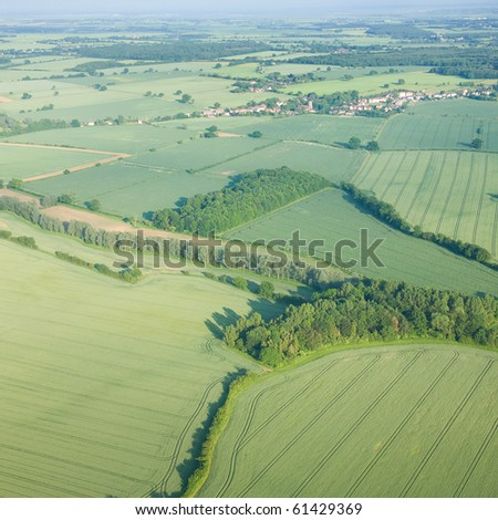 view over the early summer green fields from the air; East Anglia; UK - stock photo