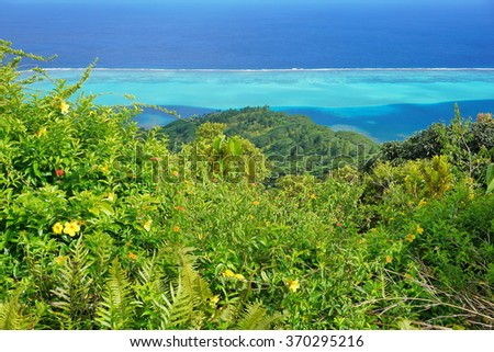 View over the lagoon from the top of the Mount Pohue Rahi with lush vegetation in foreground, Huahine island, Pacific ocean, French Polynesia - stock photo
