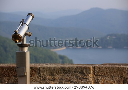 View over the mountains in Hesse, Germany, besides an old-fashioned telescope. - stock photo