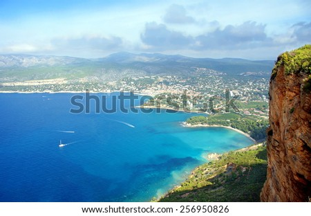 View over the picturesque village of Cassis .Seen from the famous route des Cretes ; a touristic road with beautiful views winding through the mountains and along the seaside.    - stock photo
