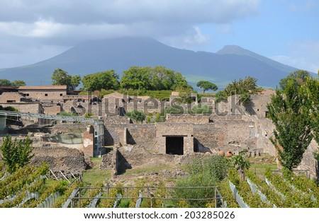 View over the ruins of Pompeii to Mount Vesuvius - stock photo