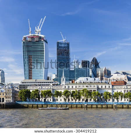 View over the Thames River in London to the city with several new skyscrapers