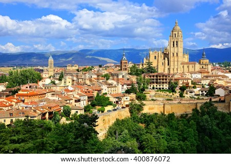 View over the town of Segovia, Spain with its cathedral and medieval walls - stock photo