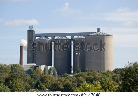 View over the tree tops to the sugar beet factory in Bury St Edmunds, Suffolk.  The largest milled sugar plant in the UK. - stock photo