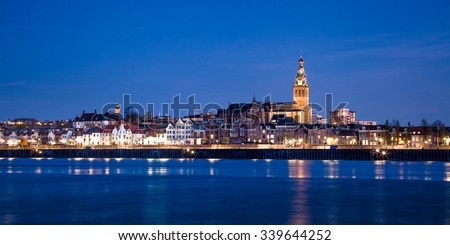 View over Waal River with the skyline of Nijmegen.  - stock photo