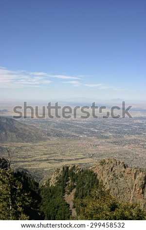 View overlooking the city of Albuquerque, New Mexico and the Sandia Mountain foothills on a sunny day - stock photo