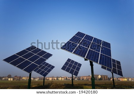 View photovoltaic panels rotating near the city