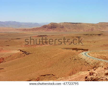 View scene of a road going to a kasbah in morocco - stock photo