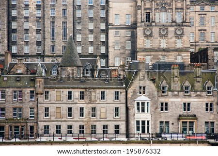 View south from Princes Street towards the Royal Mile over Waverley Train Station, showing the exterior of historic Edinburgh buildings  - stock photo