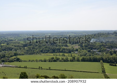 View south over the countryside from Box Hill near Dorking. Surrey. England. With heat haze. - stock photo