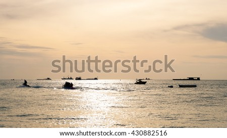 View sunrise over the calm sea with ships at anchorage