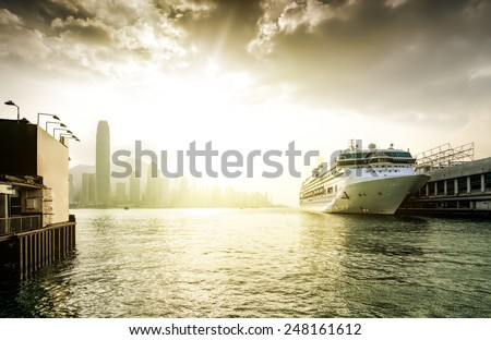 View the city at night from Kowloon promenade. Hong Kong. China. Sunset. - stock photo