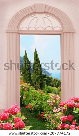 view through arched door, mediterranean landscape with hydrangeas - stock photo