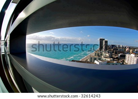 view through 28 floor with a fish-eye lens overlooking south florida skyline.