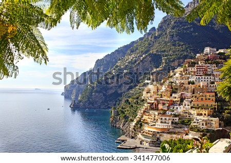 View through green leaves on the Colorful Positano town, the most famous place of the Amalfi Coast, South of Italy.  - stock photo