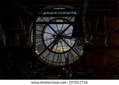 View through the clock of Musee d'Orsay where you can see Sacre Coeur basilica - stock photo