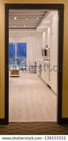 View through the door, entrance  frame. Interior design of a modern kitchen, in combination with laundry and the office room. For small condos. Vertical. - stock photo