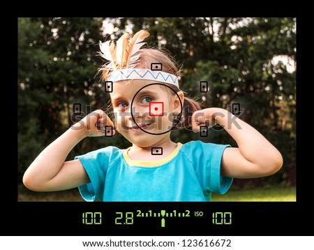 View through viewfinder during taking photos of child with DSLR camera - stock photo
