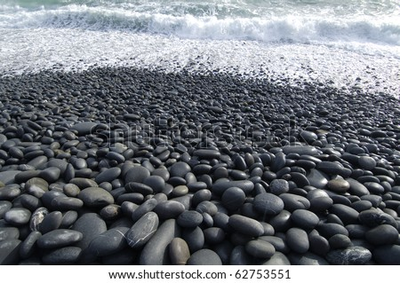 view through wet pebble on the sea - stock photo
