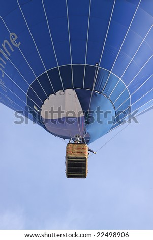 view to a blue flying balloon - stock photo